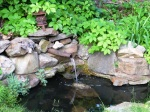 In western PA, a pipe flowing with water is a common sight.  it's our own version of a water feature